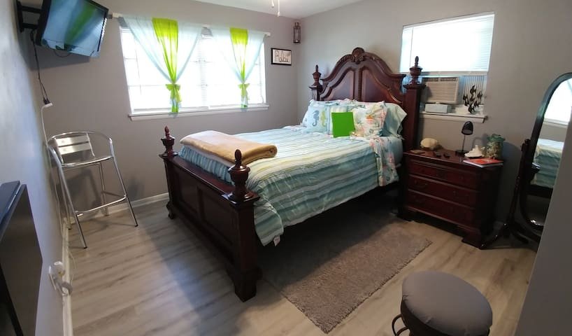 Comfortable, memory foam Queen size bed, folding work space, fridge, microwave, full mirror, swivel tv, bedside lamp, and much more.