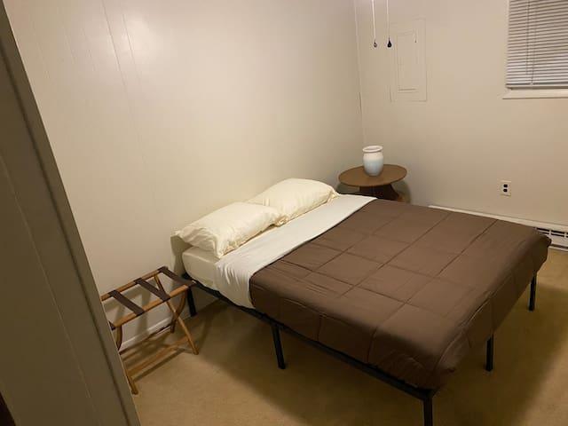 Back bedroom with luggage rack