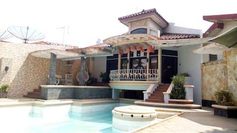 T-Rooms Homestay Palembang Syariah