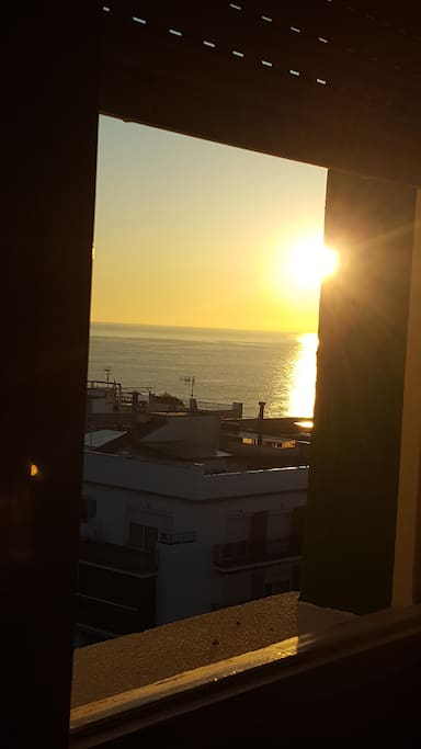 The room has a view of the sunrise and the ocean