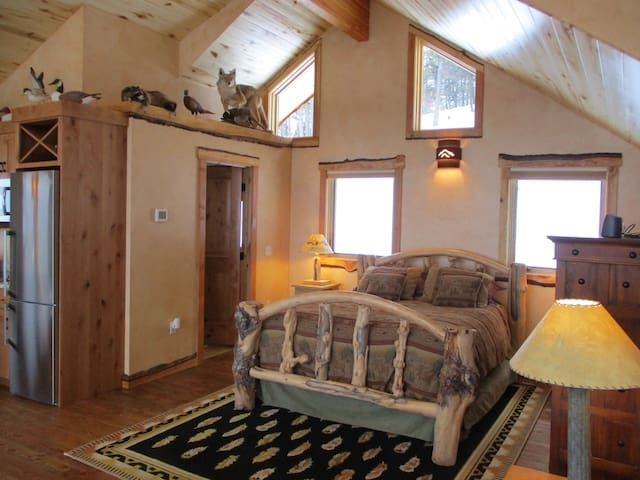 Montana Craftsman Queen Log Bed and unique wildlife and carved ducks