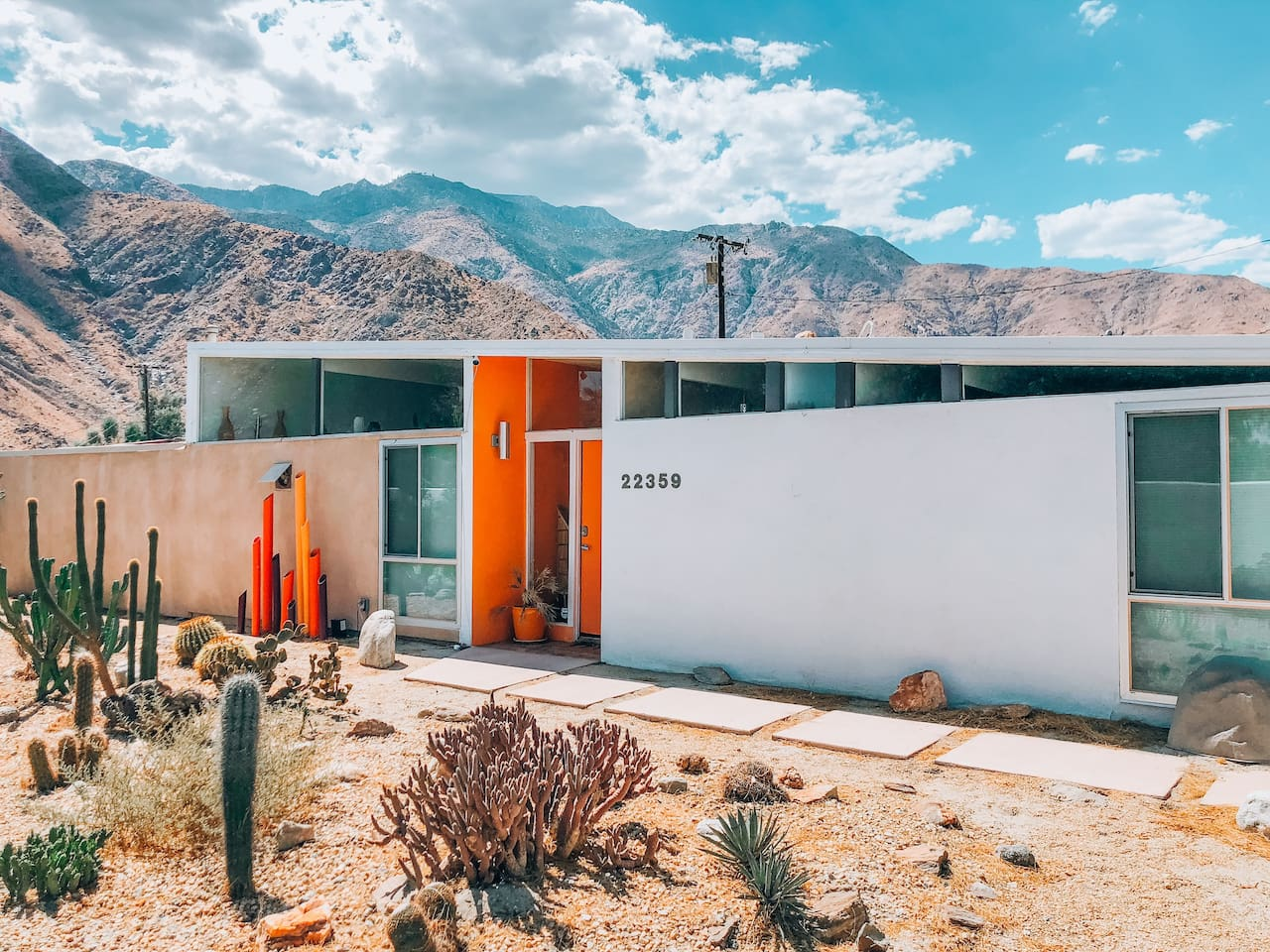 Colorful mid century butterfly roof by William Krisel