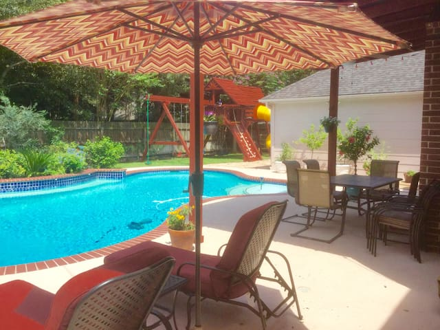 Patio area overlooking pool and play area