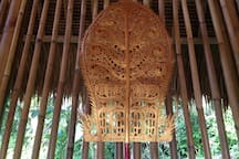 A special Galungan penjor decoration by a village artist.