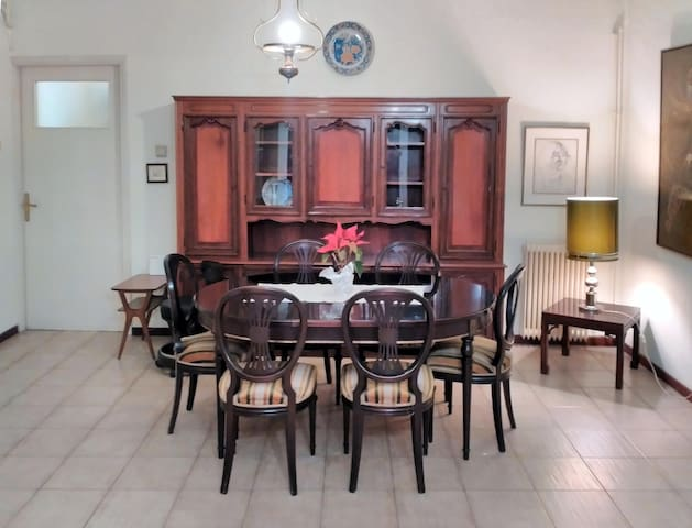 Dining area with retro solid wood furniture.