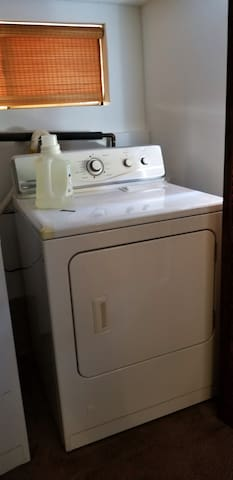 Wash and dryer behind bifold doors in laundry / guest room