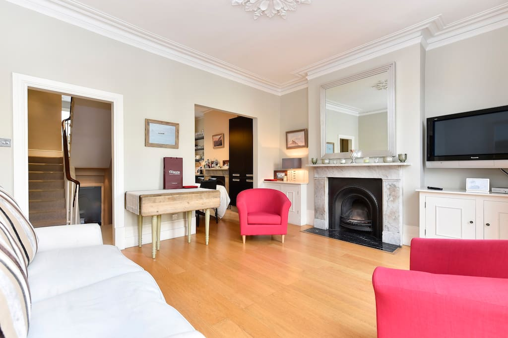 Large, spacious and light living area with cosy sofa and two armchairs, as well as a wide screen television with freeview subscription.