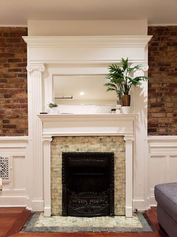 A 120 year old original Brooklyn fireplace gives a nod to the extensive history of the first suburb of Manhattan.