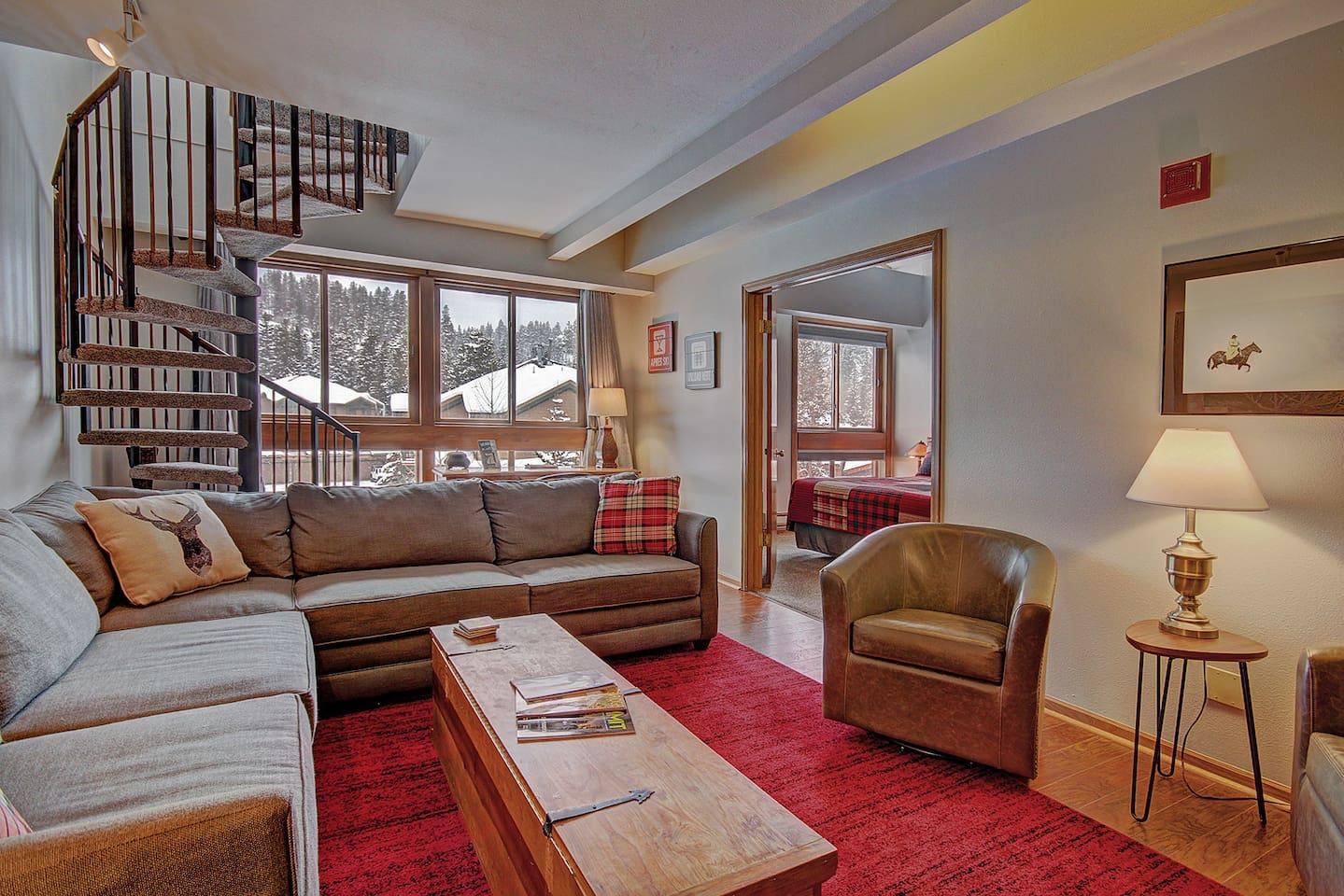 Ski Hill 22 - a SkyRun Breckenridge Property - Living area with spiral staircase to upper level