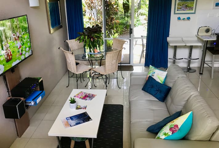 Comfortable Lounge and Dining, viewing private tropical gardens
