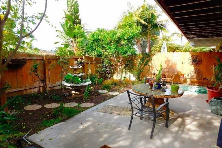 Modern condo w/ a gas fireplace, furnished patio, & private fenced yard!