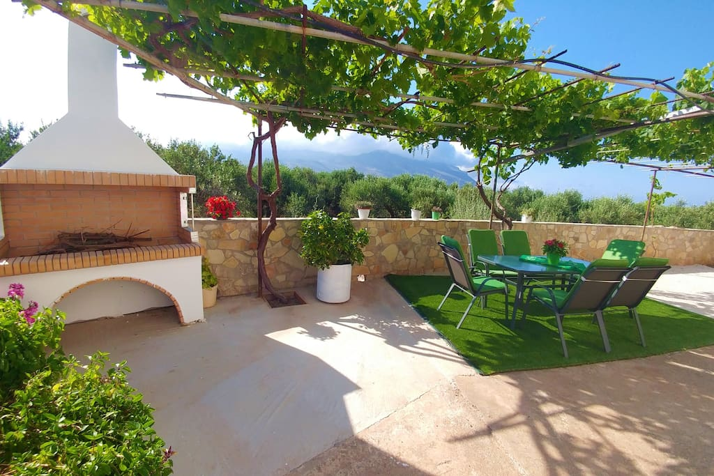 Private courtyard-garden with outdoor dining area, bbq and oven