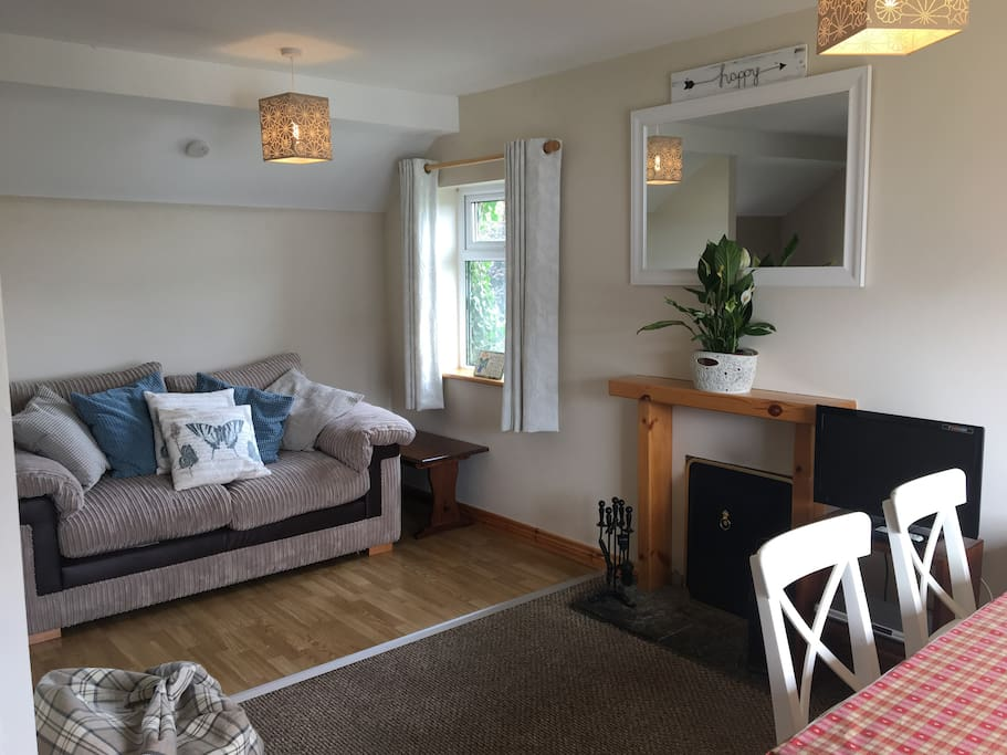 New sofa, washing machine and dining chairs in the open plan lounge/kitchen area with views over Galway Bay