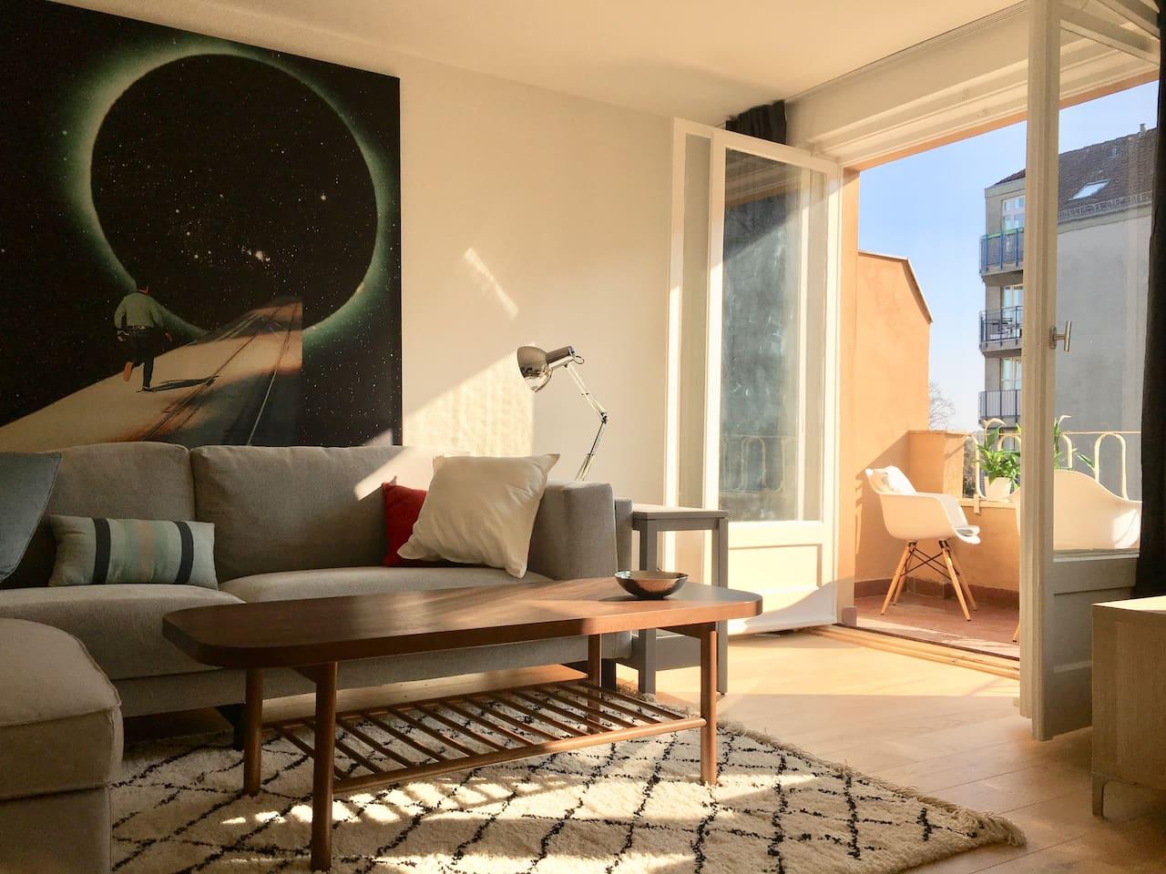 living room with sunny balcony