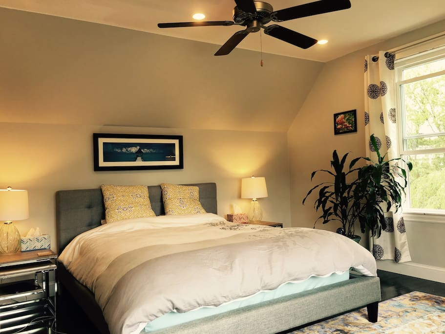 Enjoy a good night's sleep on a queen-size bed; there's AC and a fan for hot nights