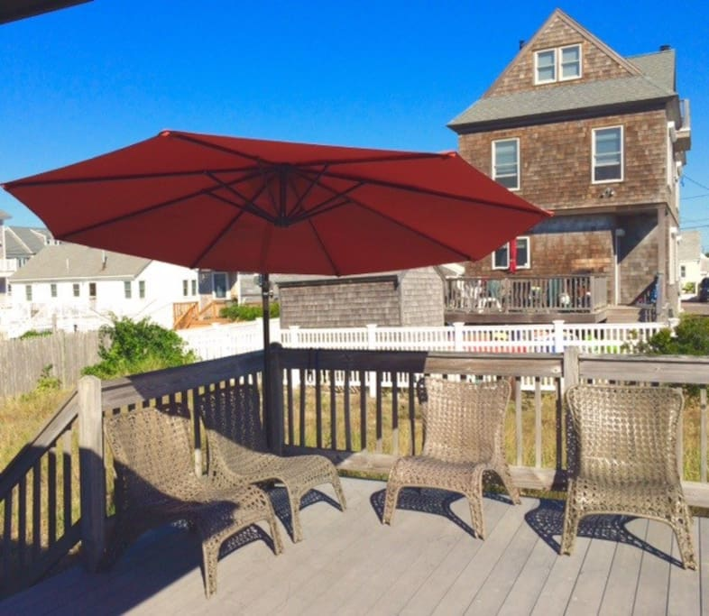 Back deck - offset umbrella, grill, seating and lounging.  Best coffee spot ever.