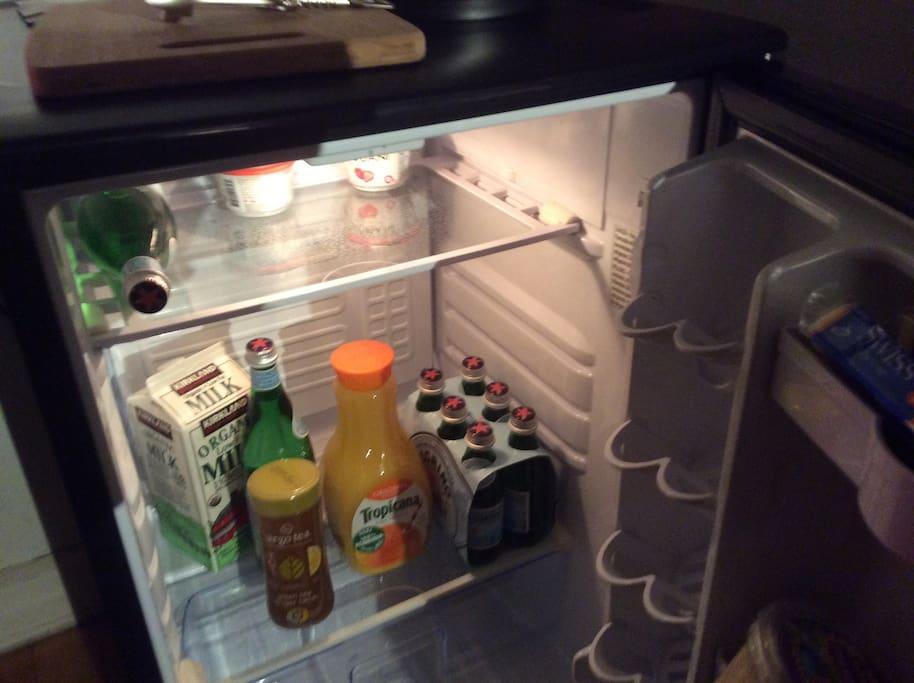 The  mini refrigerator in the kitchen.