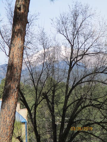 view of Sierra Blanca from the front of cabin