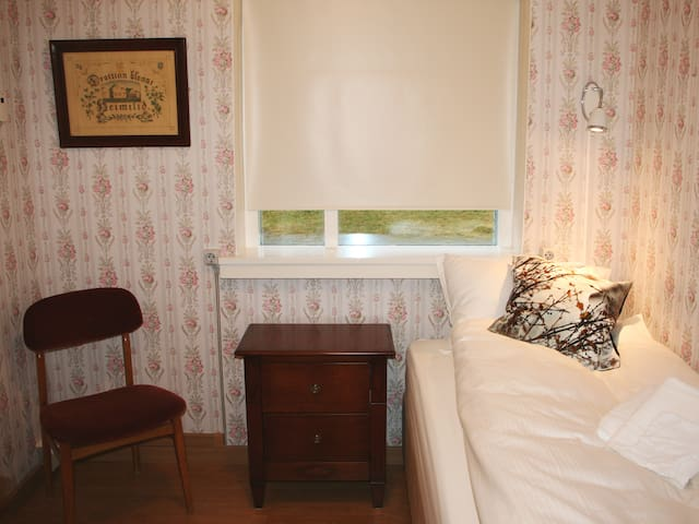 Single room. Snug and homely, decorated with an original wallpaper with a view to the Vaðlaheiði hill.