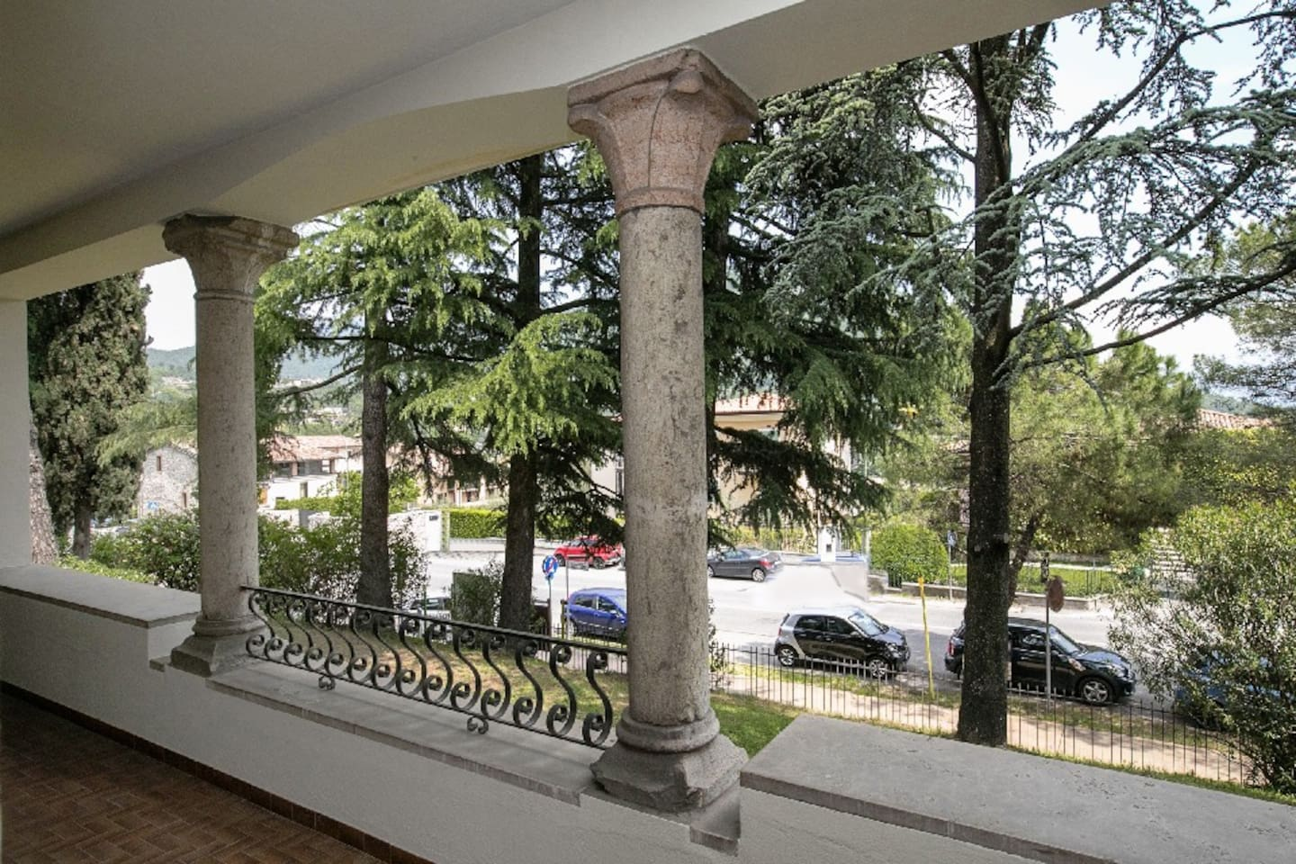 View from the portico with view on the lake at the right of the photo