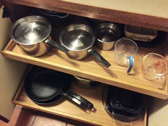 Many pots and pans.