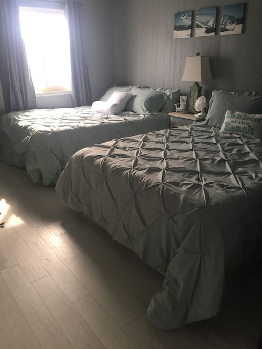 Beautiful 2nd bedroom with premium queen mattresses and bedding