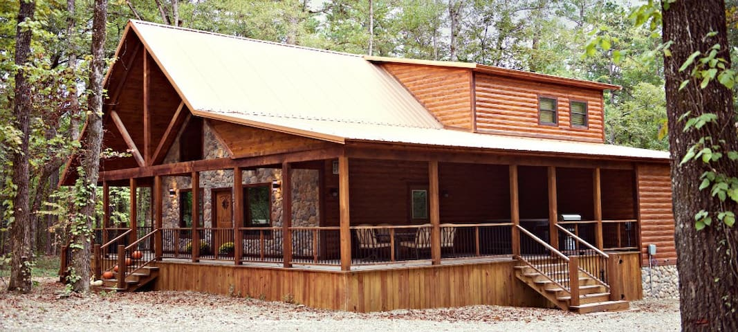 Your extravagant, wooded escape is located in Northern Hills, just off of Hwy 259.This lavish cabin comfortably sleeps 14 people, but can accommodate up to 18 with two blow up mattresses.