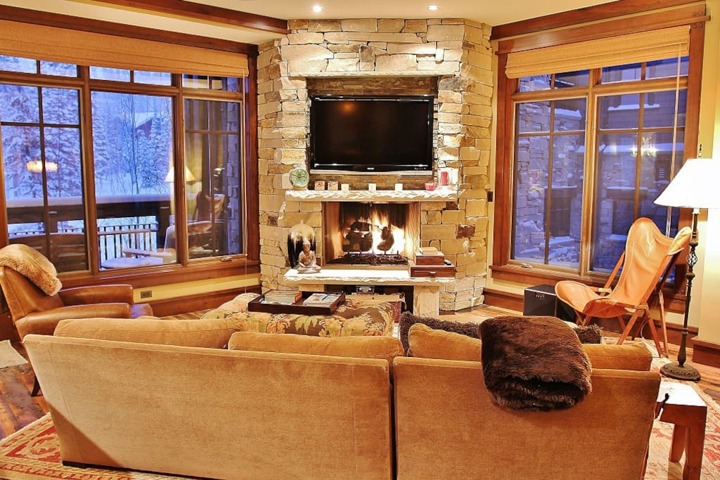 """Living room with 50"""" HD TV/DVD/Surround, fireplace, and lots of cozy seating"""
