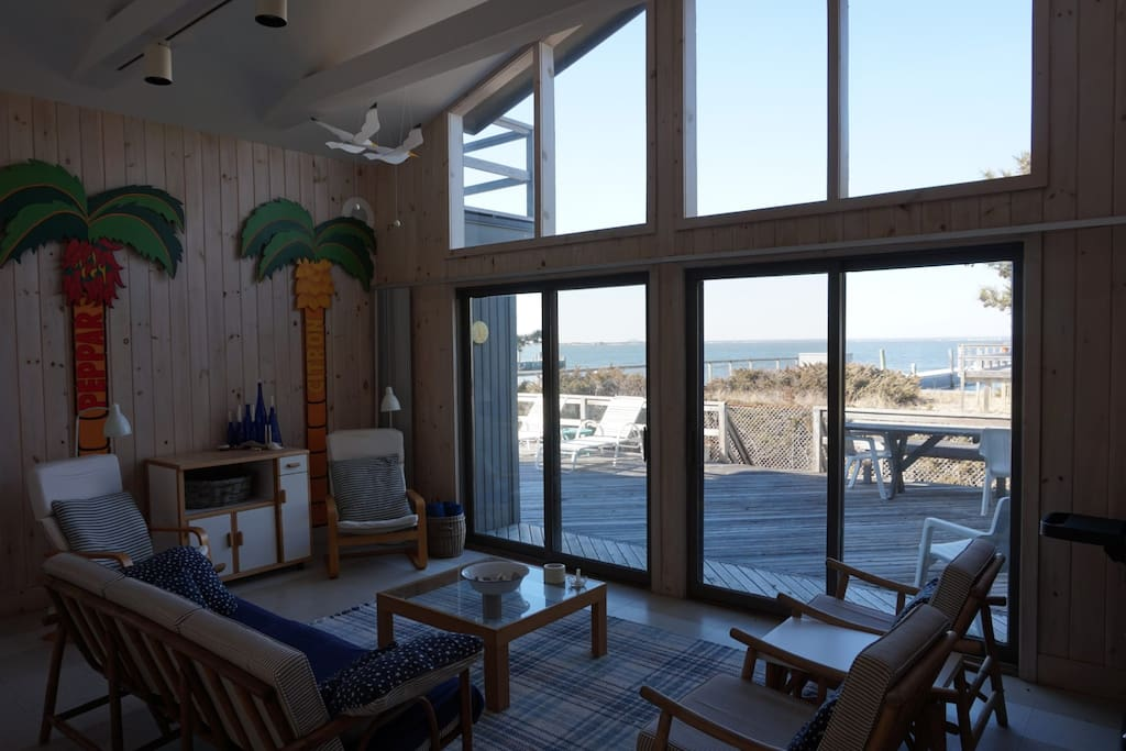 Living room with floor to ceiling windows and bay views.