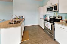 The well-equipped kitchen features a full suite of appliances.