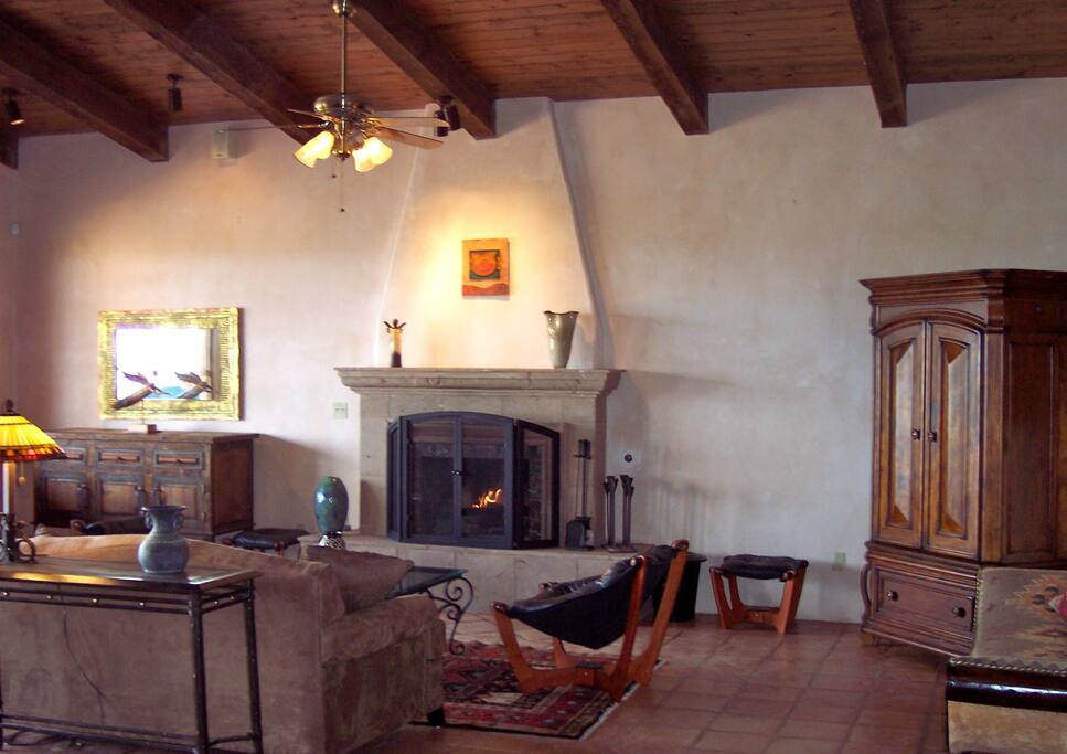 The living room features a large wood-burning fireplace
