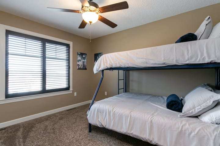 Twin bed on top. Full bed on bottom. Great for any kiddos and sturdy for adults too!