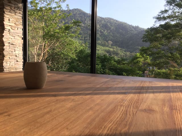 the morning sunrise, when the sun rays shining through the teakwood dining table
