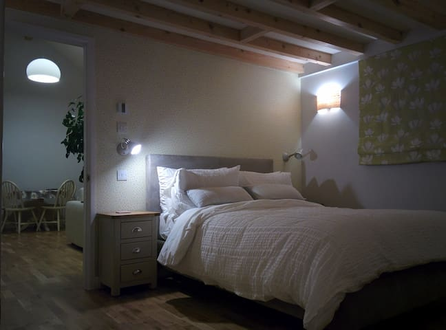 Double bed with luxury bedding, plenty of pillows and cushions