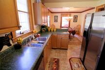 Real nice Kitchen has large refrigerator/freezer, gas range/oven/microwave, dishwasher unit, all dishes & pans