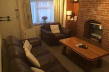 Living room, comfy leather sofa and armchair
