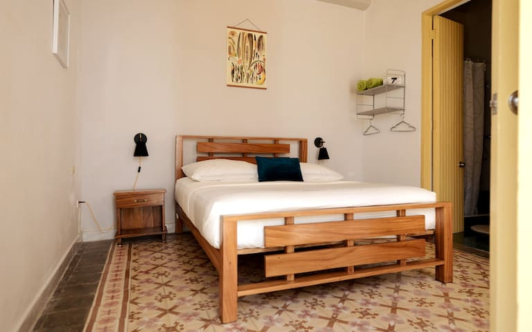 Room #1 with comfortable bed (1.60 x 2.00 m) and great pillows. Direc access to private bathroom  on the right side.