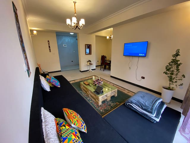 A Specious warm living room with comfortable long couch and flat screen Smart TV that offers Netflix, hulu, Youtube... and Great Wifi