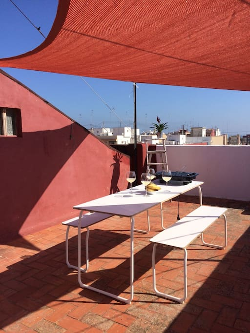 Communitarian terrace just one floor above the living room, with private furniture, barbecue and shadow veils