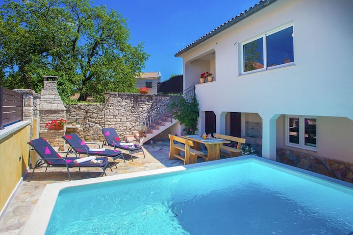 Centrally located holiday home with cosy, modern decor and private pool