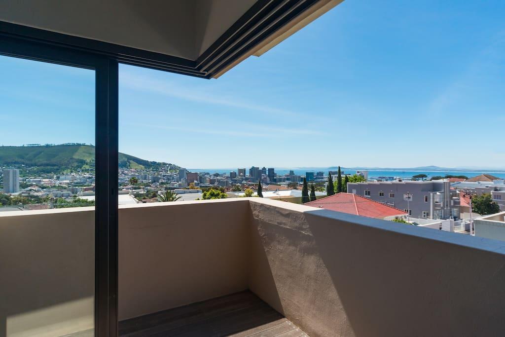 Top floor open balcony with city/ sea/ mountain views