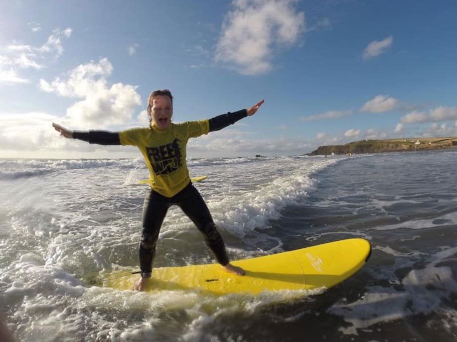 Surfing on the beach at Widemouth bay