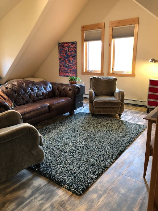 Great room living area couch chairs and flatscreen