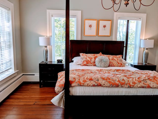 Master bedroom with king-sized bed.