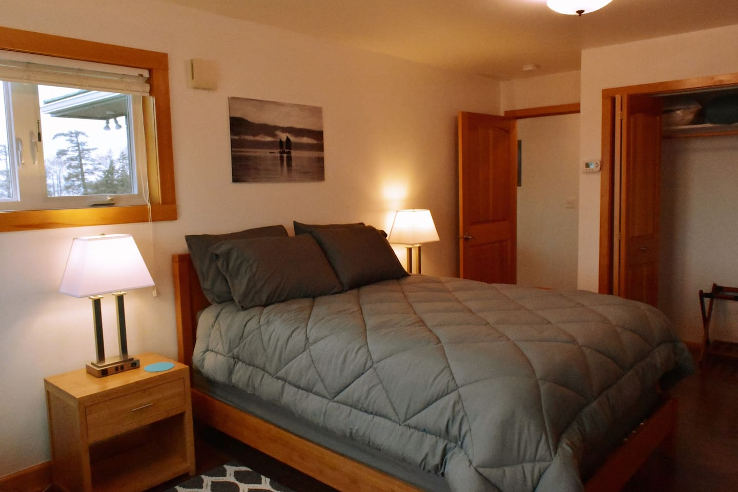 Comfortable queen size bed. This room offers stunning views; a cozy couch and a large dresser. A 30 inch television which offers Directv for your viewing. The nightstands are equipped with several USB ports for charging your electronic devices.