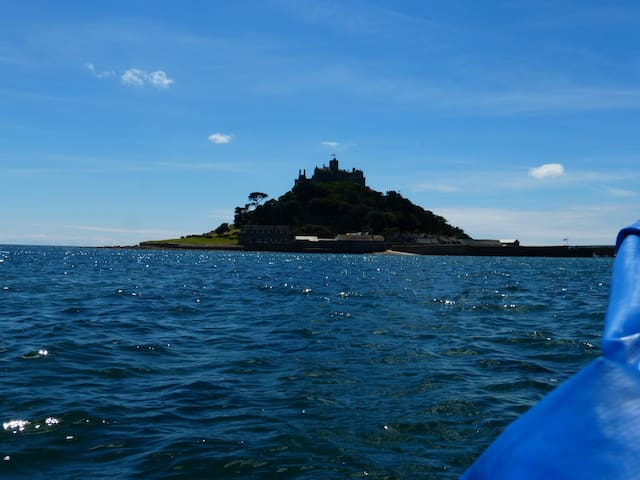 High tide on St Michael mount. One way on the boat costs £2.00.