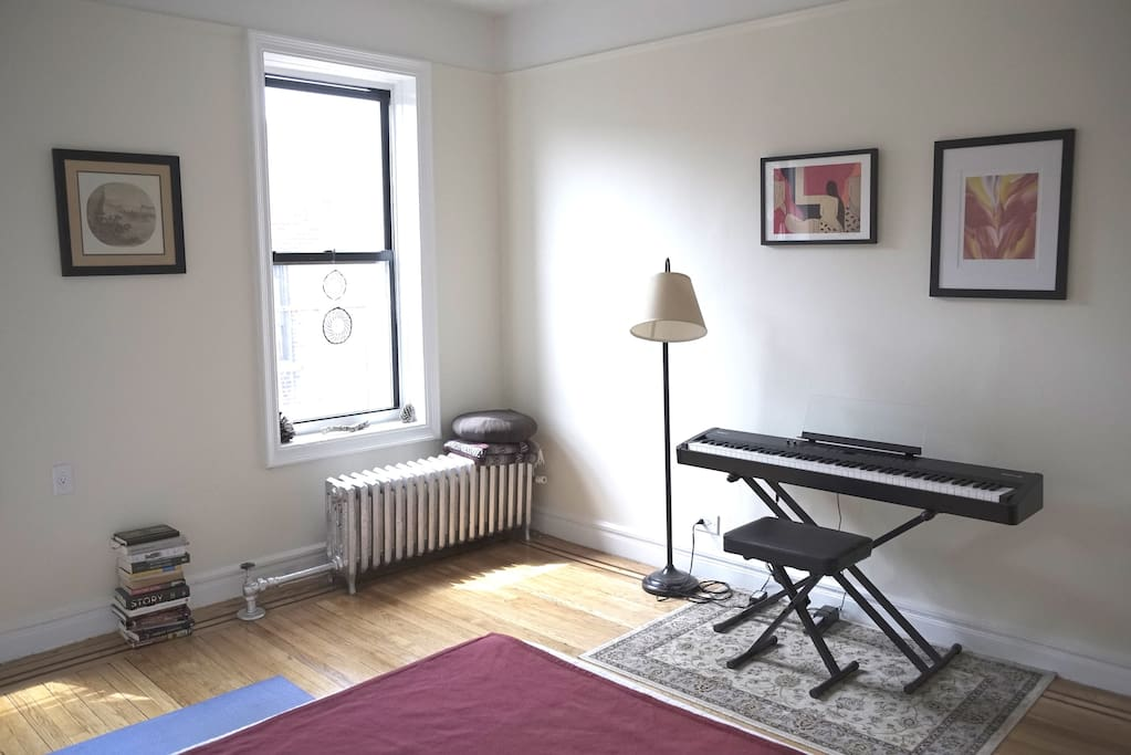 Bedroom with piano