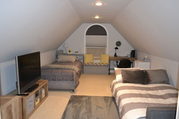 Bedroom 1 with unfolded futon/double bed and one single bed