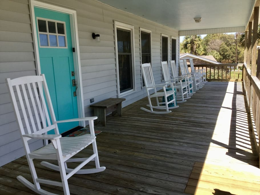 The front porch is gated and is a nice place for breakfast or read and relax. Double swing. Picnic table.  9 rockers.