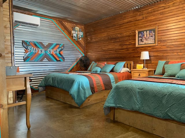 Two queen beds in the Silver Spur Cabin at The Lazy Buffalo, Southwest Oklahoma